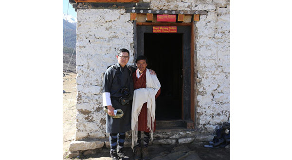 Inspiring people: His Majesty in Thanza, Lunana, with Tenzin Wangdi who operates and manages the Flood Warning Station there.