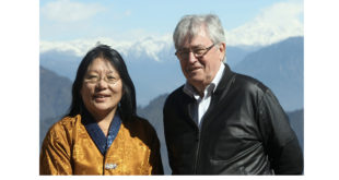 Chief of School Health and Nutrition Division, Ministry of Education, AumJamyangChoeden with David at Dochu-La Pass, on their way to visit the beneficiary schools in Punakha and Tsirang