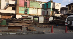 A traditional house is demolished to make way for a modern building in Thimphu